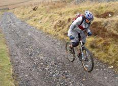 Mountain-biker-climbs